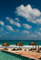 Paradise (idashum) Tags: vacation cloud holiday tourism beach gulfofmexico pool clouds umbrella relax mexico nikon paradise december bluesky cancun blueskies relaxation ida shum d300 hcs icanseeclearlynow idashum clichesaturday