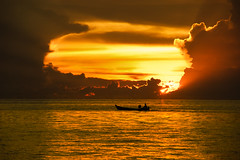 Togean sunset (green.pit) Tags: ocean travel sunset red beach water silhouette yellow clouds indonesia islands boat reisen asia asien explore frontpage sulawesi gettyimages inseln togean togian pitgreenwood