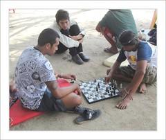 Chess problem on the beach . (Franc Le Blanc .) Tags: people bali beach boys sitting candid chess sit seated pantai kuta chessplayers earthasia