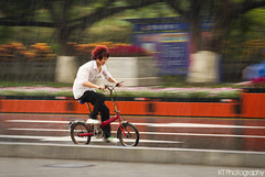 Running from the Rain (gtsomething) Tags: china wet rain bike bicycle movement chinese splash panning zhuhai typhoon soaked hydroplane caughtintherain ridingintherain gtsomething