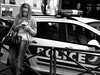 Texting with police car behind (vieweronline) Tags: street city urban blackandwhite bw paris france streets monochrome noiretblanc cities streetscene policecar streetscenes barbes texting g12 urbanscene canong12