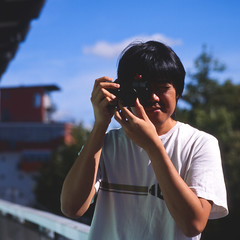 Thanawat and his Konica Hexar (christian.senger) Tags: camera blue portrait sky man 6x6 film clouds rollei analog rolleiflex mediumformat geotagged outdoors europe university dof kodak squareformat peppers sl66 konica ektachrome ulm lightroom hexar e100g vuescan gettygermanyq4 christian_senger:year=2012