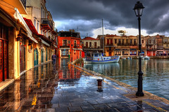Have you ever seen the rain? (Theophilos) Tags: old sea sky reflection rain clouds boats harbour crete venetian rethymno