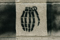 """Hand"" Grenade - Street Art - Austin, Texas (tangaloo) Tags: street black brick art skeleton stencil war paint joke weapon irony pun"