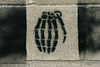 """Hand"" Grenade - Street Art - Austin, Texas (tangaloo) Tags: street black brick art skeleton stencil war paint joke weapon irony pun"