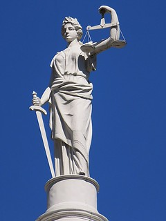 From http://www.flickr.com/photos/59958425@N04/13313869395/: Statue of Justice atop New York City Hall, 260 Broadway, New York City. This statue is a rarity in that here Justice is not wearing a blindfold.