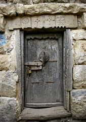 Old Jewish House Door, Al Hajjara, Yemen (Eric Lafforgue Photography) Tags: door wood building history vertical architecture outside construction asia day exterior outdoor lock empty decoration middleeast nobody nopeople architectural arabia housing historical stonewall daytime yemen preserved technique padlock preservation craftsmanship colorphoto dayview woodendoor colorpicture placeofinterest alhajara arabiafelix arabianpeninsula hajjarah stonebrick hajarah alhajjara alhajarah traditionalconstruction alhajjarah thickwall colourpicture localmaterial alhajjerah alhajrah buildingskill detailofarchitecture hajjazmountains blissfularabia harmoniousarchitecture