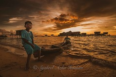 Kids are ready to play... (Syahrel Azha Hashim) Tags: ocean travel light vacation portrait holiday detail beautiful kids clouds sunrise island nikon colorful dof getaway horizon naturallight tokina portraiture malaysia handheld local shallow woodenboat simple dramaticsky 11mm sabah sandybeach seagypsies ultrawideangle semporna d300s maigaisland syahrel