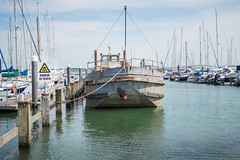 Ghost Ship (NVOXVII) Tags: uk reflection texture water sign metal marina outdoors coast boat spring dock nikon rust harbour may bluesky hampshire 1855mm seafront dslr newforest d3200