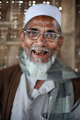 DELIGHTED (Apratim Saha) Tags: old family sunset portrait people brown india white man color smile smiling yellow vertical shirt proud scarf pen canon silver beard outside outdoors happy photography eos 50mm glasses adult natural bokeh pov indian teeth 14 gray gesturing culture potter naturallight oldman cap elderly 5d protrait inside dailylife mustache gesture kolkata nationalgeographic slowshutterspeed westbengal northindia siliguri graying apratim lifeinindia lifeculture apratimsaha westbengalbengal apratimsahacom iconicphotographs nationalneographic