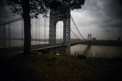 The George Washington Bridge (GWB) on 11/22/2011 (mudpig) Tags: nyc newyorkcity longexposure bridge light shadow cloud mist newyork tree grass leaves geotagged newjersey traffic manhattan nj gothamist georgewashington hdr gwb fortlee georgewashingtonbridge drizzle washingtonheights lighttrail mudpig stevekelley