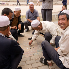 Fun and Games (kevinschoenmakers) Tags: china street game color colour men laughing square asian fun outside religious asia muslim islam religion central chinese games east laugh muslims centralasia province islamic gansu eastasia dahejia