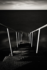 plunge (Nate Parker Photography) Tags: ocean longexposure sea blackandwhite bw seascape black beach monochrome stairs stair massachusetts down le descend mass falmouth abyss thecape haveaniceday westfalmouth