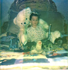 Turtlehead (DewDrop17) Tags: old boy cute love film childhood children polaroid toys colorful child quilt little adorable dragons turtles instant nostalgic balance grainy playtime dinosaurs longnecks badquality sharptooth giantteddybear