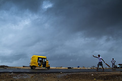 Chennai Rain (Arun Titan) Tags: mg1618 canon canon7d canon18135 india 7d aruntitan arun arun4884 arunr arunkumar photography photo photos southindia poverty povertyinindia naturallight availablelight ambientlight flickr village travel travelphotography streetphotography street road roadside blackandwhite blackandwhitephotography clouds rainy rainyclouds srinivasabeachroad marinabeachchennai chennairain bluesky umberlla cycle rain rainyday chennaiauto yellow yellowauto autorickshaw autorickshawindia cricket cricketplayer streetcricket beachcricket monsoon