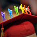 A valedictorian is ready to make the leap from undergraduate to graduate along with his colorful paratrooper army men.