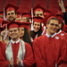 Graduates smile as they are officially recognized as having fulfilled the requirements needed to receive their degrees.