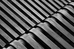 Curved Steel (PeteZab) Tags: nottingham uk greatbritain england blackandwhite bw abstract texture lines modern bench table mono furniture steel diagonal curve canoneos50d petezab peterzabulis sigma1770f284dcmacroos