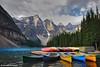 crayon canoes at moraine lake (Rex Montalban Photography) Tags: trees mountain lake canada colours canoe alberta hdr moraine banffnationalpark glacial morainelake canadianrockies hss photomatix rexmontalbanphotography sliderssunday