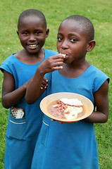 School Lunch (cowyeow) Tags: poverty africa school girls portrait food playing students girl smile kids children fun lunch happy kid beans education child play eating african poor young smiles volunteering uganda volunteer primary cornmeal littlegirls schoollunch kasese africanfood craftday kilembe