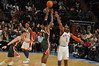 Brandon Jennings Shooting over AMARE STOUDEMIRE