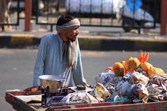 Papaya seller (deus77) Tags: street india man shot market candid indian mango bazaar capture seller jaipur rajasthan
