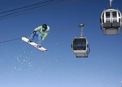 Riding With The Gondola (dualdflipflop) Tags: mountain snow sports sport snowboarding jump nikon nikond100 sigma skiresort mammoth snowboard d100 dslr minarets mammothmountain sigma2870mmf284d
