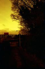 Station Track (Saturated Imagery) Tags: red silhouette 35mm fire iso200 epson praktica v500 filmslr vivitar28mmf25 prakticatl5b lomographyredscalexr devlopedthephotoshop