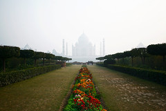 Taj Mahal (Jitendra Singh : Indian Travel Photographer) Tags: winter sky cloud india colour reflection tree history water weather horizontal fog architecture outdoors photography dawn memorial asia day minaret muslim tomb crowd tajmahal agra nopeople unescoworldheritagesite worldheritagesite dome marble thepast masterpiece shahjahan treelined formalgarden mughal uttarpradesh traveldestinations mughalarchitecture buildingexterior placeofinterest internationallandmark largegroupofpeople mumtajmahal builtstructure earthasia traditionallyindian incidentalpeople