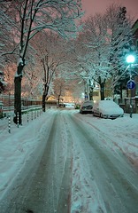 (podoboq) Tags: street pink winter sky snow cold color tree car sign night dark evening track alone loneliness sofia branches trace pole bulgaria covered narrow paved ligh