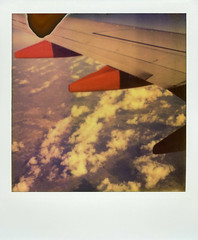 Air Travel (Nick Leonard) Tags: vacation sky orange white southwest film clouds analog plane airplane polaroid nick scan transportation divot southwestairlines airtravel landcamera polaroidsx70 instantfilm airplanewings epson4490 polaroidsx70landcamera firstflush colorshade integralfilm nickleonard polaroidsx70model2 theimpossibleproject ndpackfilter px680 px680ff