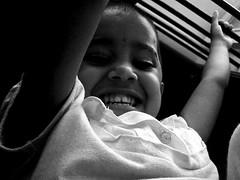 Pradeepa Laughter ([PKPC]) Tags: light portrait people blackandwhite bw india art girl face childhood kids contrast dark children photography mono photo kid interesting exposure child play natural image noiretblanc expression retrato indian innocent young naturallight portrt kinder noflash nios nia kind soul casual enfants criana chennai crianas menina gaze enfant nio fille pretoebranco tamil mdchen oneperson  lightart girlchild    enblancoynegro  puer effigies lightdance puella childrenonly filii  indiangirlchild schwarzundweis nigrumetalbum haedos pkpcphotography pkpcwork