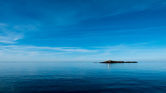 Outpost Skagerrak (jarnasen) Tags: ocean blue sea sky copyright lighthouse seascape nature skyline gteborg island sweden gothenburg calm boating handheld sverige freehand minimalism skagerrak archipelago hav skrgrd ar lx100 nordiclandscape jarnasen panasonicdmclx100