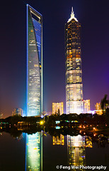 Shiny twin brothers (Feng Wei Photography) Tags: china city travel light urban color reflection building tourism beautiful beauty vertical skyline architecture modern night skyscraper reflecting high amazing colorful asia cityscape shanghai metro vivid structure east business highrise metropolis oriental financial metropolitan height jinmaotower urbanscape finance lujiazui swfc gettychinaq2