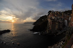 Riomaggiore, Cinque Terre sunset (webeagle12) Tags: ocean park sunset sea vacation italy orange house fish eye bay coast boat nikon europe riviera italia village dusk 10 liguria cliffs fisheye national tiny terre mm nikkor cinque riomaggiore ligurian d90 thefivelands