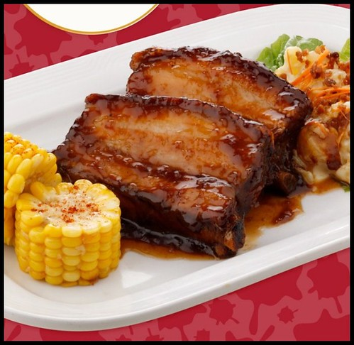 BBQ Baby Back Ribs served with warm BAcon Potato Salad and Corn on the cob