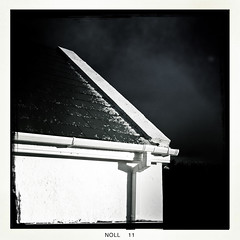Cith 's Dealán/After a Hail Shower (soilse) Tags: ireland roof light blackandwhite sun cold sunshine weather hail wall clouds dark shower december darkness cloudy ridge brightlight squareformat sunburst gutter outhouse clearance donegal cloudysky whitewall darksky paintedwall iphone wintersun brightsunshine slates brightsun hailstones slateroof 2011 gaothdobhair heavyshower plasteredwall afterashower anghaeltacht slatedroof appleiphone hailshower tírchonaill iphonecamera cnocastolaire westdonegal whitepaintedwall hipstamatic winteryshowerwinter