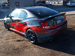 Matte black vehicle wrap - gloss overlay - scion - rear angle (Soapoint Graphics) Tags: sign promotion mobile advertising design marketing graphics display vinyl murals wrap company printing installation shuttle signage format lettering banners custom decals largeformat tradeshow sponsor fabricate wallmural businesssign lightedsign advertisingdesign outdooradvertising vehiclewrap standups buswrap largeformatprinting matteblack printedtshirt mobilemarketing customdesign cardecal businessdesign carwrap autowrap boatwrap vanwrap mobilebillboard vehiclegraphics customprint customsignage motorcyclewrap truckwrap trailerwraps suvwrap racecarwrap customfabrication customcarwrap popupdisplay silkscreenedtshirt graphicwrap fleetvehiclewraps printedgraphics printedclothing backlitgraphic graphicsadvertising flatblackwrap racewrap carwrapinstallation letteringdecal largebuildingsign customsignfabrication signcabinet 3mcertifiedinstall 3mperfered