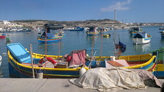 Traditional fishing boats at Marsaxlokk (hugovk) Tags: cameraphone autumn port boats nokia fishing october niceshot harbour painted traditional malta colourful hvk fishingboat n8 syksy carlzeiss marsaxlokk 2011 n800 nokian800 hugovk camera:Make=nokia nokian8 exif:Focal_Length=59mm exif:Flash=autodidnotfire exif:Aperture=28 exif:ISO_Speed=105 camera:Model=n800 exif:Orientation=horizontalnormal exif:Exposure=1299 traditionalfishingboatsatmarsaxlokk meta:exif=1363882412