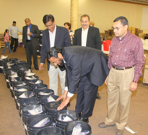 Alliance volunteers in Houston filling AICB buckets for flood affected families in Sinhd Pakistan    (31)