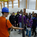 Peter showing students a scale-model wind blade to middle school students on a tour of the Offshore Wind Laboratory