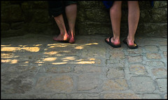 Barefoot at Mont Saint-Michel (Hetx) Tags: old shadow two woman sunlight mountain man france male castle feet abbey saint stone wall female naked french island coast michael spring ancient europe toes european shadows skin fort pavement sandals bare duo michelle medieval norman cobble cobblestone barefoot april heels barefeet stmichel dual fortification normandy soles mont middleages battlement ankles michell montstmichel calves mediaeval monestary saintmichel normand shadowy calfs