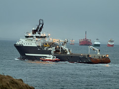 Olympic Hera transferring pilot to Orkney Island Council Marine Services Pilot boat John Rae - Busy day at Hoxa Sound