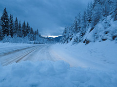 Winter Driving (Chicken) Tags: road morning blue trees winter snow canada cold forest dawn highway driving bc britishcolumbia freezing fresh transportation getty snowcovered blueriver