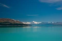 Mountains in Summer (Jocey K) Tags: blue trees newzealand lake snow mountains rocks southisland lakepukaki