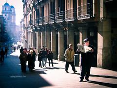 Sunday morning news (Blogomentary) Tags: madrid street morning light man reading morninglight newspaper spain shadows streetphotography sunrays contrasts calledetoledo plazamajor suntrails blogomentarycom