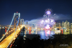 San Francisco 2012 Fireworks Celebration (Darvin Atkeson) Tags: sanfrancisco california bridge light skyline display fireworks 4th july explore embarcadero newyearseve suspensionbridge newyearsday 2012 yerbabuenaisland darvin thebigone explored  atkeson darv liquidmoonlightcom lynneal sanfranciscothebigone