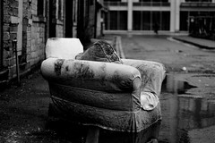 Outdoor Furnishing (Elliot young) Tags: old white black reflection wet puddle outside outdoors one living fly chair bradford sweet furniture empty room dirty sofa drugs needles armchair raining odeon furnishing tipping mucky uncivilised desisted