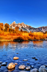 Along the shoreline of Schwabacher Landing anf the Tetons (Ronnie Wiggin) Tags: travel lake mountains fall reflections landscape nikon fallcolors shoreline jackson getty grandtetons mirrorimage tetons jacksonhole gettyimages grandtetonnationalpark d300 teatons fallfoilage schwabacherlanding jacksonwy snowcoveredmountains cruisecozumel nikond300 dcpt dirtcheapphototours rwigginphotos ronniewiggin cozumelwaterphotos