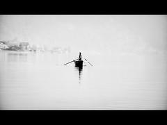 Fisherman (ceca67) Tags: light people bw lake photography schweiz switzerland boat photo fisherman nikon swiss less 2011 d90 ceca